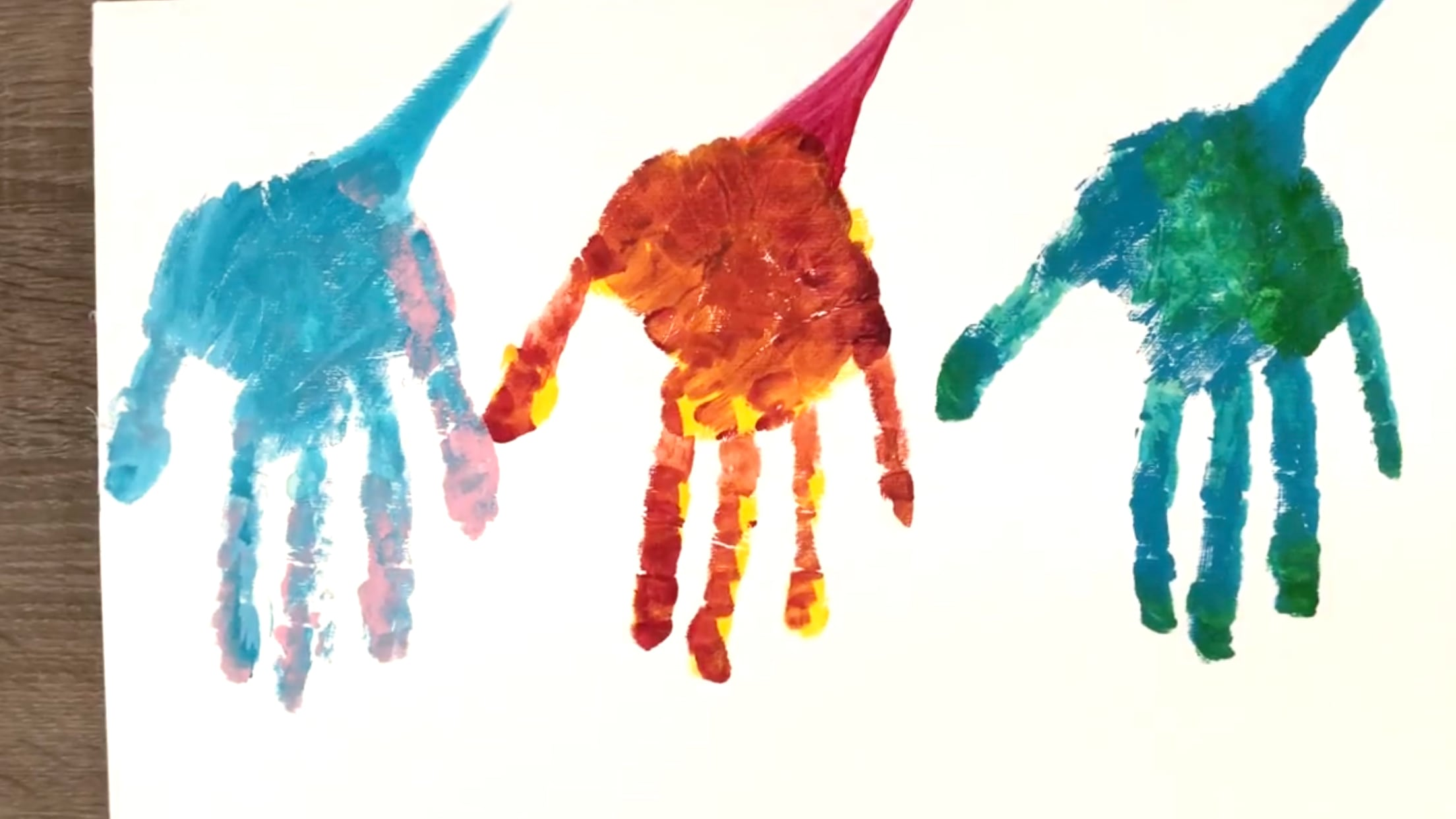 Finger Painting Dinosaurs with Tails