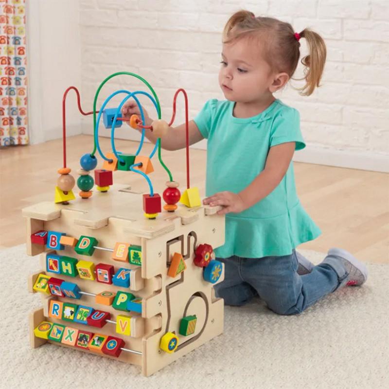 Giochi montessori: cubo multi-attività